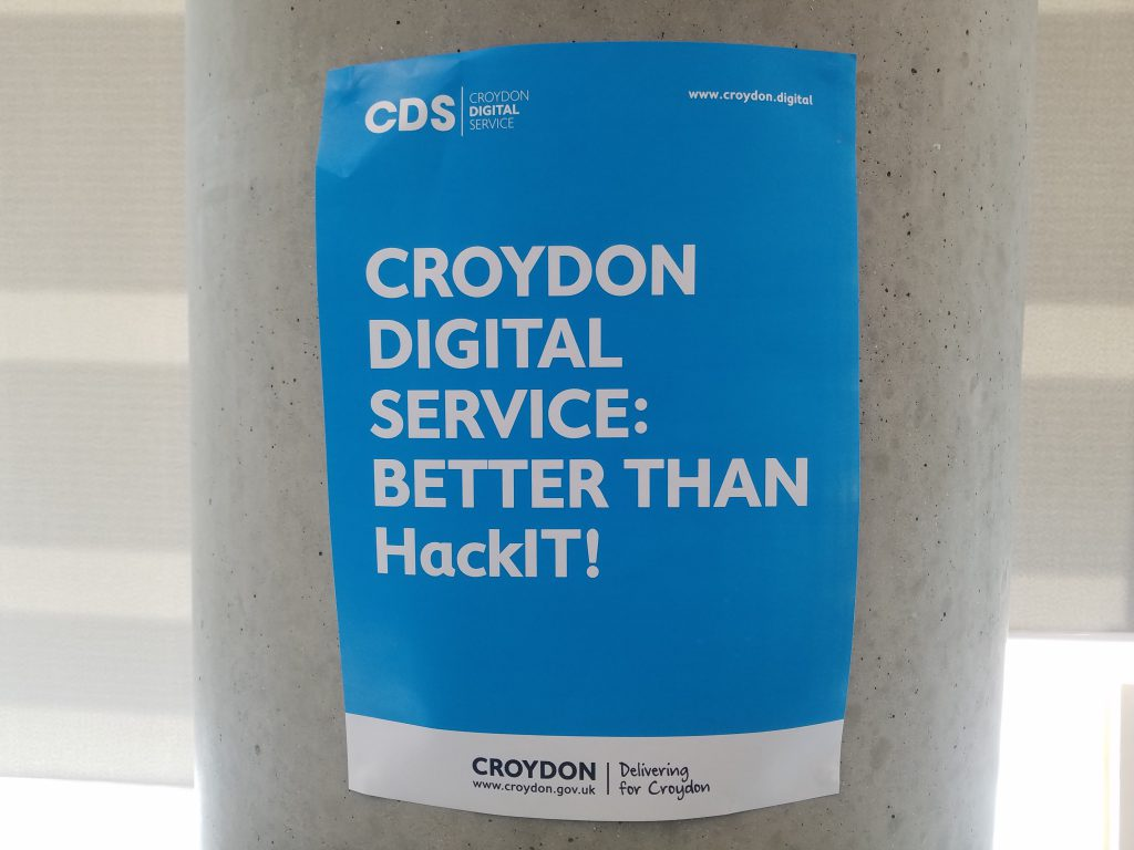 "A poster at CDS reading ""Croydon Digital Service: Better than HackIT!"""